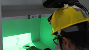 Mobile In-Situ Pick-by-Vision: Order Picking Support Using a Projector Helmet